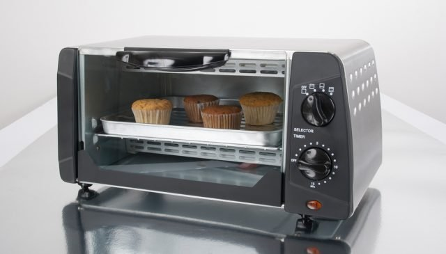 best toaster ovens under $50   photo of muffins baking in small oven