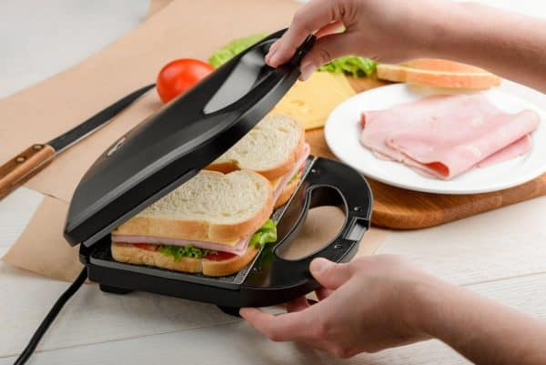 Best Sandwich Maker | photo of male hands using a panini press to make sandwich