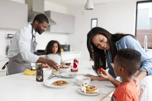 Best Pancake Griddle   Family In Kitchen At Home Making Pancakes Together