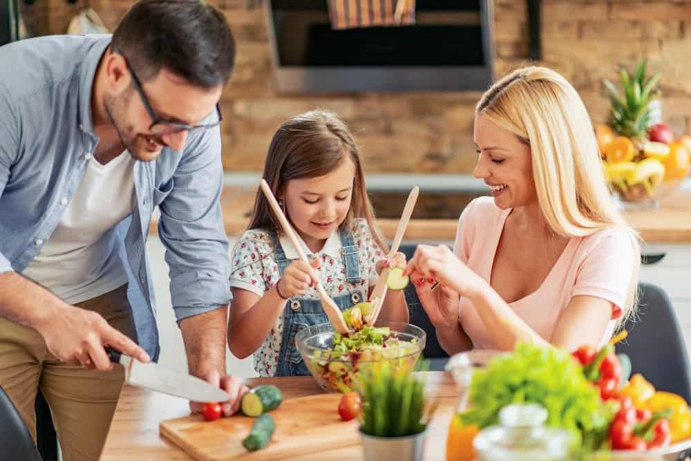 Better Family Nutrition   photo of family making dinner salad