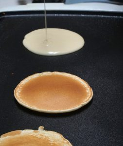 Best Pancake Griddle   photo of pancakes cooking on hot griddle
