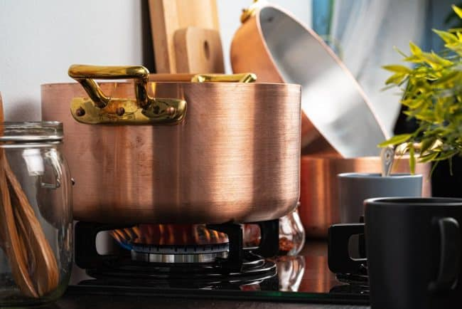 Best Pots and Pans for Gas Stove | photo of copper stock pot on gas flame