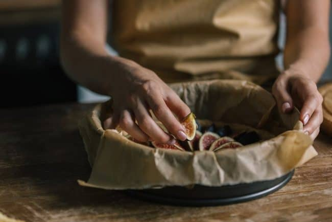 Substitutes for Parchment Paper   photo of hands arranging figs inside parchment lined pan