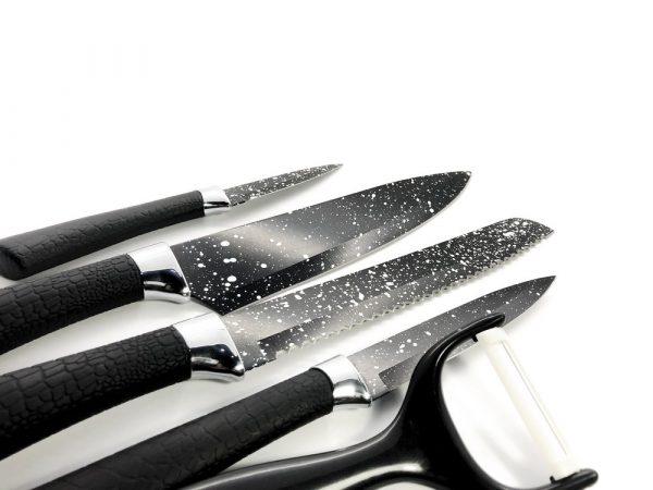 Ceramic vs Stainless Steel Knives | photo of isolated black knife set