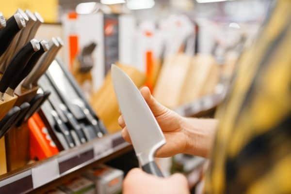 Ceramic vs Stainless Steel Knives | photo of man choosing knives in store