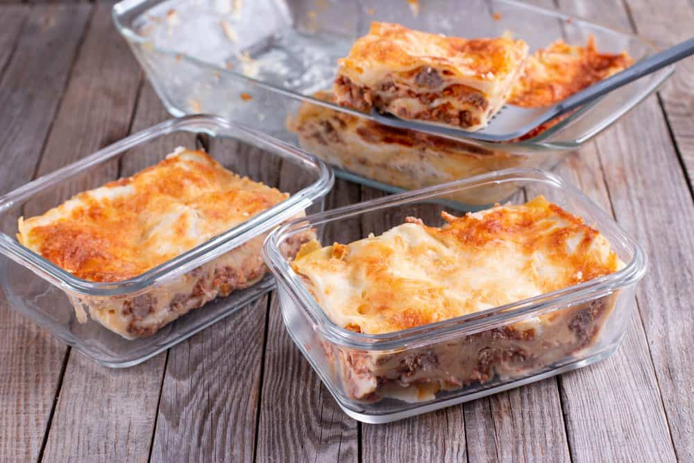 Family Freezer Meals | photo of several glass containers of lasagne