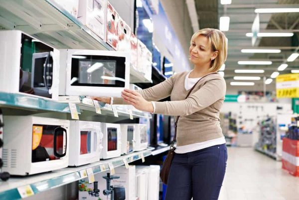 Best Microwave Under $100 | photo of mom shopping for affordable microwave